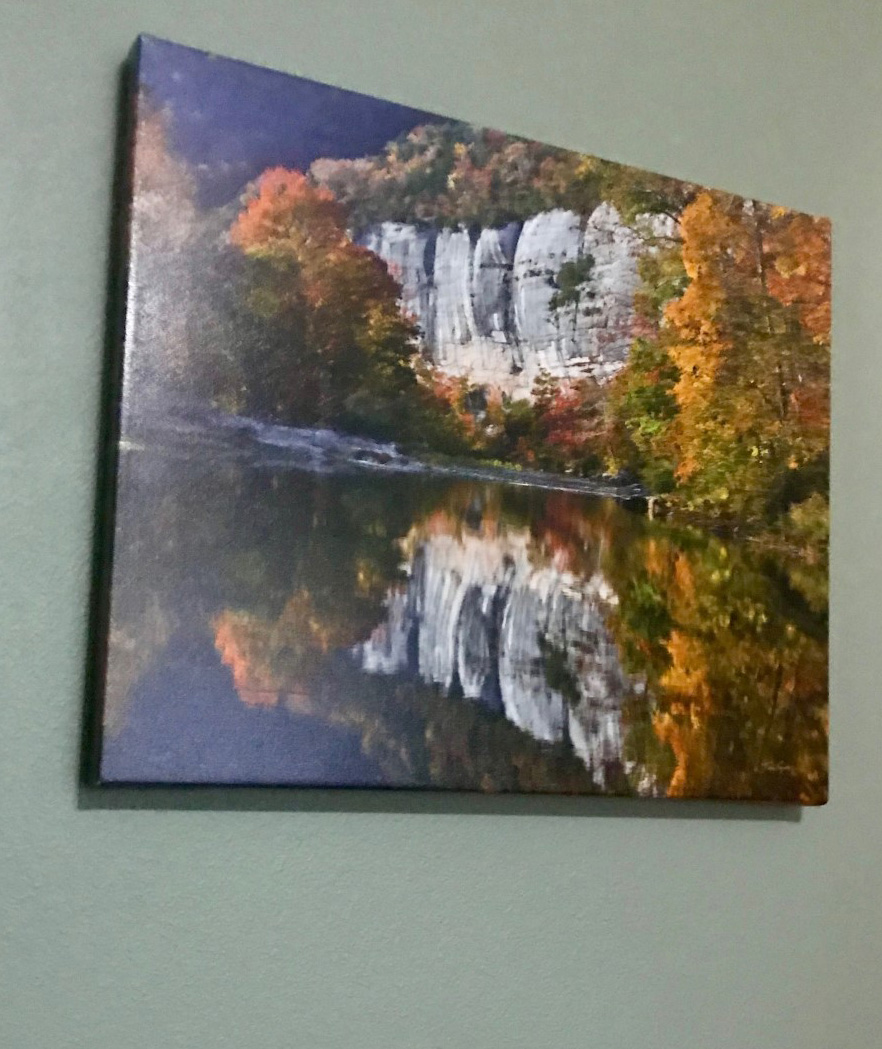 An image of a photograph on canvas by Tim Ernst in the wall of my home.