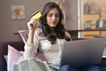 Image of woman in front of lapbtop with credit card